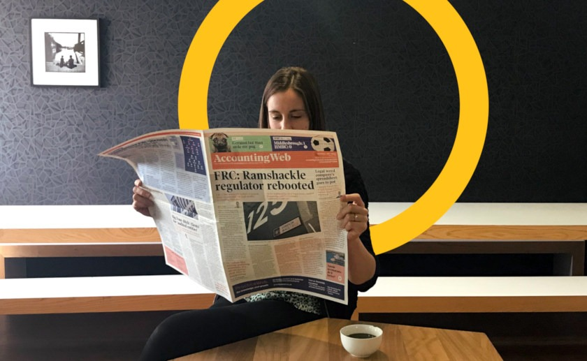 Woman reading newspaper headlines
