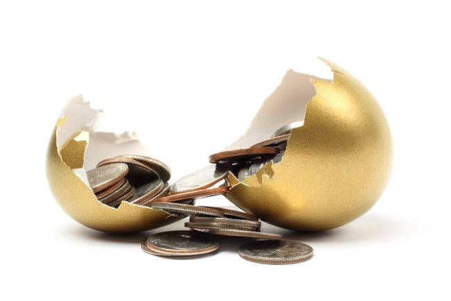 A golden egg hatching money.